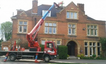 cleaning gutters for a commercial building in Ludlow