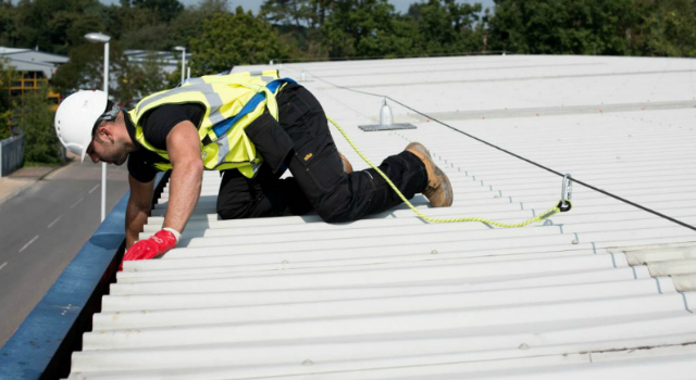 commercial gutter cleaner on a roof top