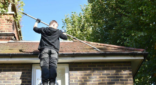 gutter cleaner using a telescopic pole