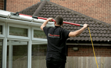 cleaning a conservatory roof in Homerton